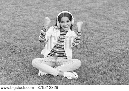 Healthy Lifestyle And Relax. Yoga Girl. Small Kid In Headphones. Summer Playlist. Enjoy Spring Natur