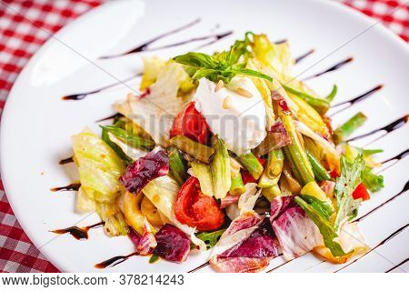 Salad With Green Beans, Tomatoes, Bell Pepper, Ricotta Cheese And Mixed Greens On White Plate. Close