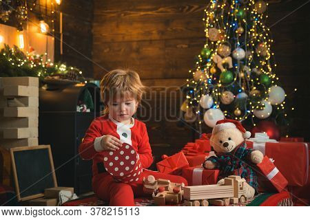 Opening Gift. Lovely Baby Enjoy Christmas. Family Holiday. Boy Cute Child Cheerful Mood Play Near Ch