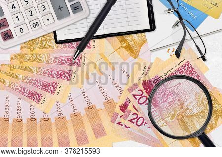 20 Belorussian Rubles Bills And Calculator With Glasses And Pen. Tax Payment Season Concept Or Inves