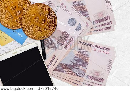 500 Russian Rubles Bills And Golden Bitcoins With Smartphone And Credit Cards. Cryptocurrency Invest