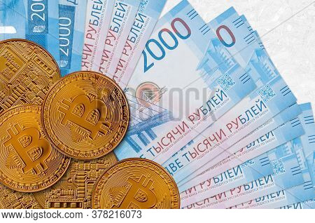 2000 Russian Rubles Bills And Golden Bitcoins. Cryptocurrency Investment Concept. Crypto Mining Or T
