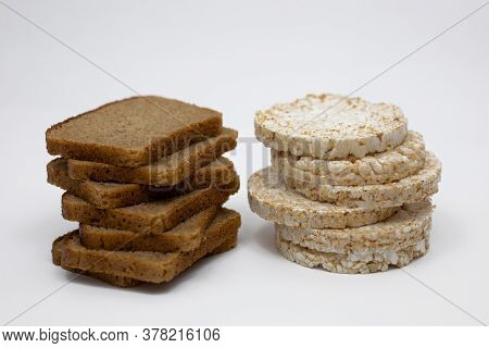 Wholemeal Rye Bread And Rice Waffles On A White Background