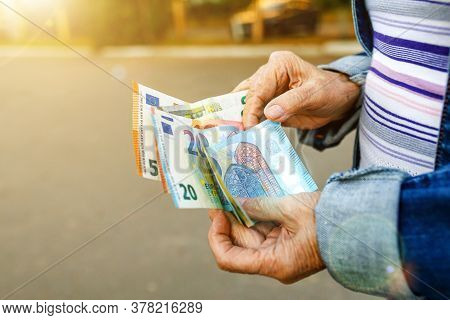 Euro Banknotes In Hands Of Elderly Woman. Pension Payments In Europe, Retirement Savings Or Benefits