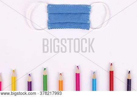 Back To School Background With Supplies And Face Mask, Copy Space.