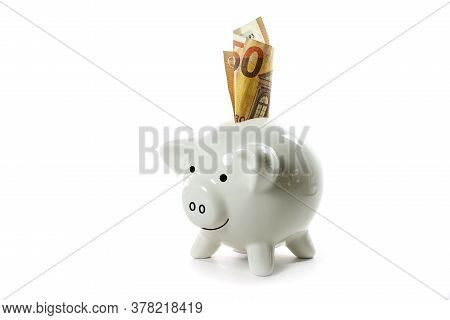 Lucky Porcelain Piggy Bank With A Fifty Euro Bill, Isolated With Small Shadows On A White Background