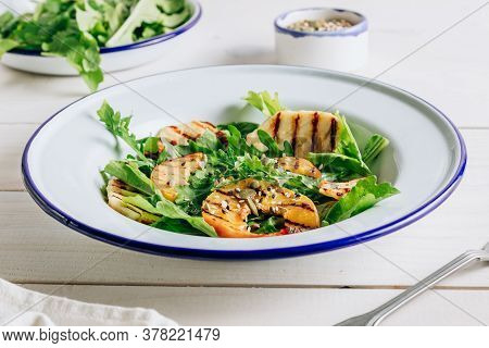 Grilled Halloumi Cheese Salad With Peach And Arugula On A White Wooden Background. Healthy Food Conc