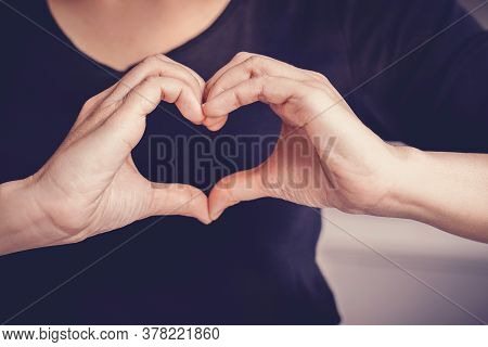 Woman Making Hands In Heart Shape Sign, Heart Health Insurance,social Responsibility, Gratitude,dona