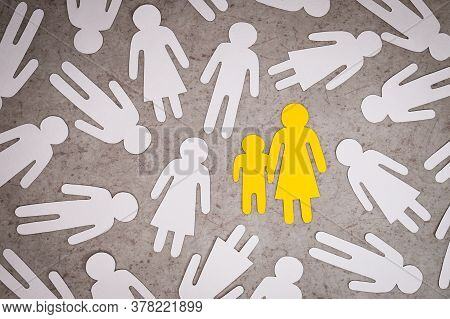 Yellow Paper Figures Of Children And Woman Stands Alone. Indifferent Silhouettes Of People Around Th