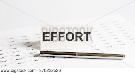 Text Effort On Stickers,pen On The Background Of Documents. Financial Bookkeeping, Accounting Concep