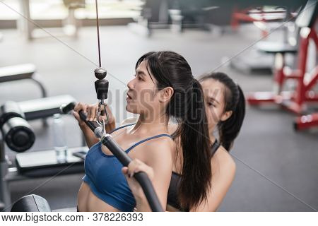 Bodybuilder Of Women Training Exercise Workout At Fitness Gym In Sportswear With Personal Trainer Co