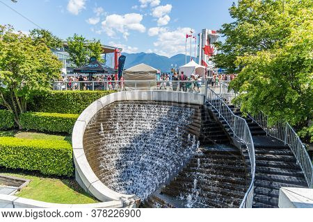Vancouver, British Columbia / Canada - 07/01/2015. People Enjoying The Surroundings At Canada Place,