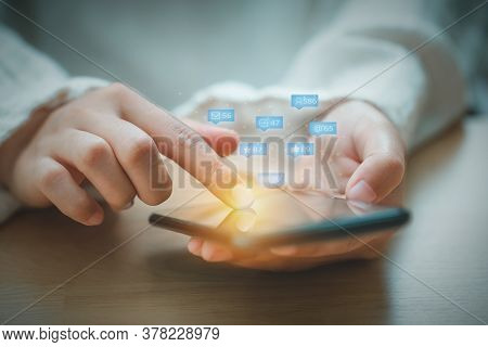 Asian Woman Using Mobile Phone For Checking Social Media Interactions On Mobile Phone With Notificat
