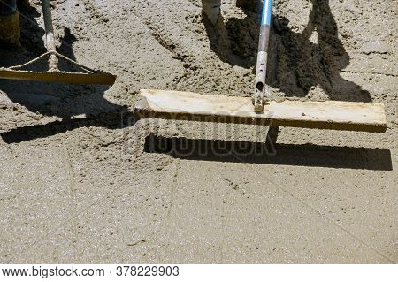 Cement In Front Of Sidewalk A New Building Under Construction Worker Concrete Surface On New Sidewal