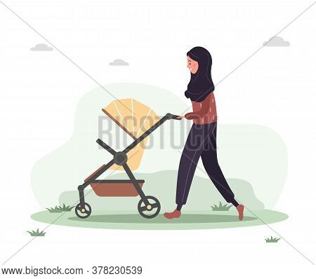 Young Arab Woman Walking With Her Newborn Child In An Pram. Girl On A Walk With A Stroller And A Bab