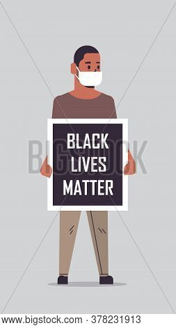 African American Man In Mask Holding Black Lives Matter Banner Campaign Against Racial Discriminatio