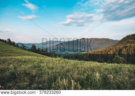 Top View On An Empty The Hills. Cloudy Summer Day. Beautiful Landscape Of Altai Mountains With Grass