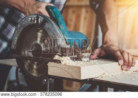 Carpenter Working On Wood Craft At Workshop To Produce Construction Material Or Wooden Furniture. Th