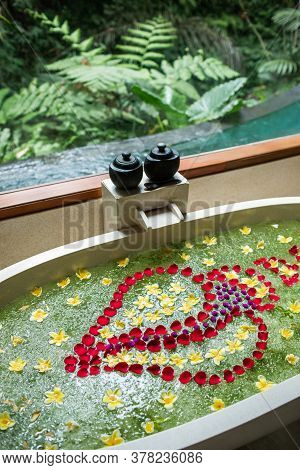 Luxury Stone Bath Tub With Tropical Flowers For Beauty Spa Treatment, Relaxation In Hotel. Jungle Wi