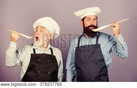 Culinary Dynasty. Mature Bearded Men Professional Restaurant Cooks. Teaching Culinary. Culinary Book