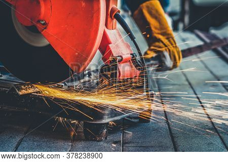 Professional Mechanic Is Cutting Steel Metal With Rotating Diamond Blade Cutter. Steel Industry And