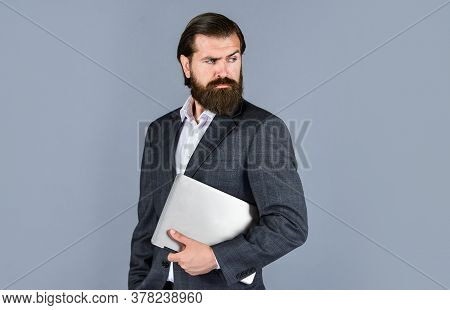 Confident Businessman With Laptop. Brutal Male With Beard In Suit. Handsome Ceo Hold Computer. Boss