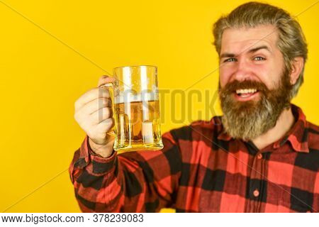 Ipa Beer. Stylish Bartender Or Barman In Bar. Recreation. Man Hold Glass Of Beer. Hipster At Bar Cou