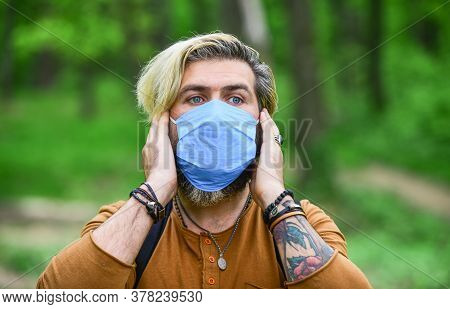 Hipster Protecting From Air Contamination Or Coronavirus. Virus Infection. Man Enjoy Nature Wearing