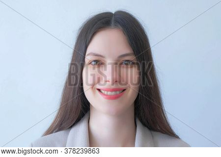 Closeup Portrait Of Brunette Young Woman In Suit Smiling On White Backgroundlooking At Camera. Beaut