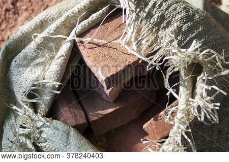 Macro Shot Of A Suck Full Of Damaged Bricks Or  Ceramic Tiles