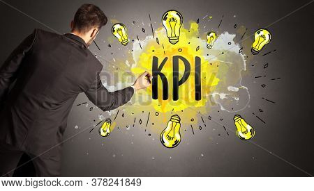 businessman drawing colorful light bulb with KPI abbreviation, new technology idea concept