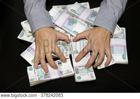 Lust For Money. Large Stack Of Banknotes, Russian Rubles, Banknotes 1000 Rubles. Hands Are Grabbing