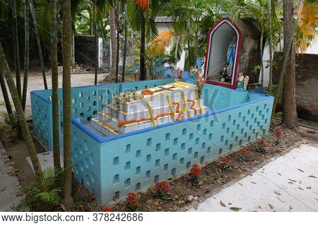 KUMROKHALI, INDIA - FEBRUARY 24, 2020: The tomb of a Croatian missionary, Jesuit father Ante Gabric, decorated on the occasion of his 105th birthday in Kumrokhali, West Bengal, India