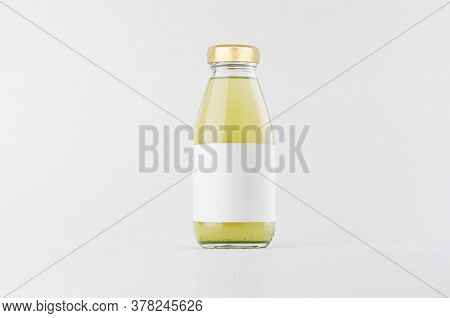 Green Fruit Juice In Glass Bottle With Gold Cap And White Blank Label Mock Up On White Background Wi