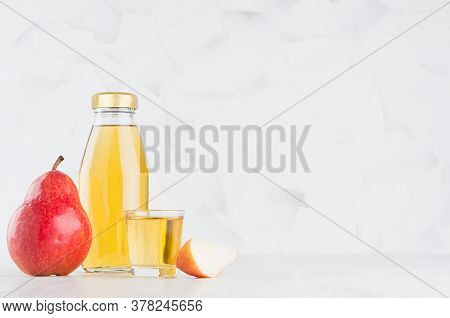 Bright Yellow Transperent Pear Juice In Glass Bottle Mock Up With Wine Glass, Fruit Slice On White W