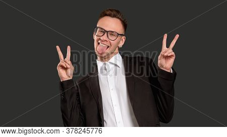Amused Guy Portrait. Fun Lifestyle. Enthusiastic Business Man Cheering Up Sticking Tongue Out Showin