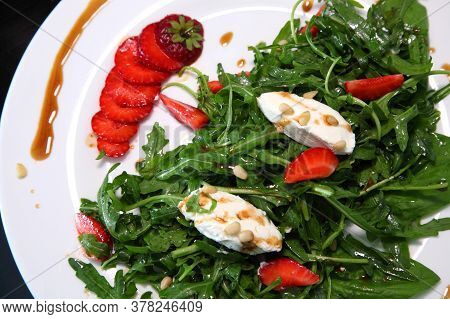 Salad With Arugula, Cream Cheese And Strawberries. Salad With Arugula And Strawberries. Rucola And S