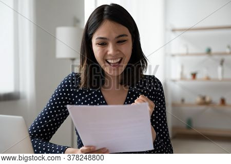 Overjoyed Asian Girl Excited With Good News In Letter