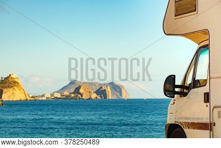 Motor Home On Spanish Coast Sea Shore. Castle San Juan On Mountain In The Distance. Aguilas, Murcia