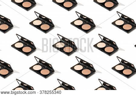 Black Compact Palette With Foundation, Powder, Bronzer, Open With A Mirror. Applying A Makeup Tone F