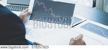 Trader Businessmen Analyze Stock Graph And Report, Set Targets For Online Forex Trading Market Manag