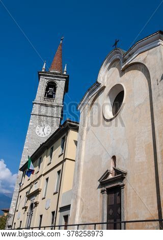 Street View Of Santa Marta Church And The Tower Of Saint George (san Giorgio) Church Under A Blue Sk