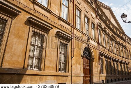 Street View Of Colorful Building Facade With Ornate Windows And Door In Town Of Casale Monferrato, P