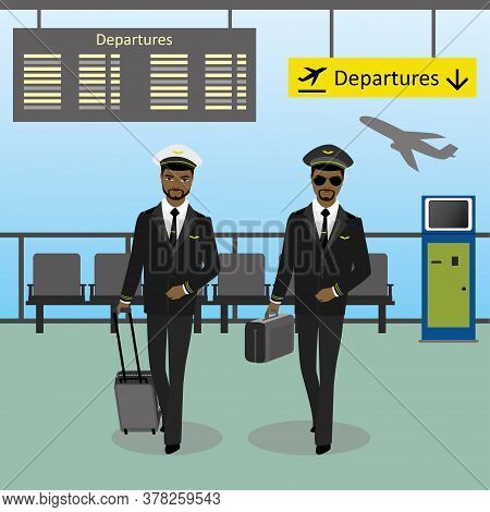 African American Male Pilot And Co-pilot Walks On An Airport Wit