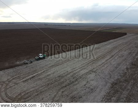 Tractor Plows A Field, Aerial View. Agricultural Landscape.