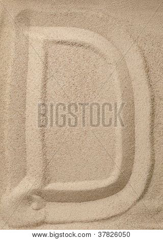 Letter D from sand