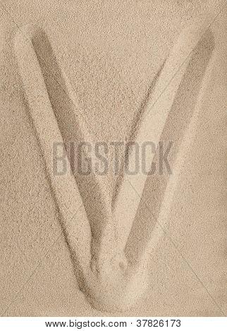 Letter V from sand