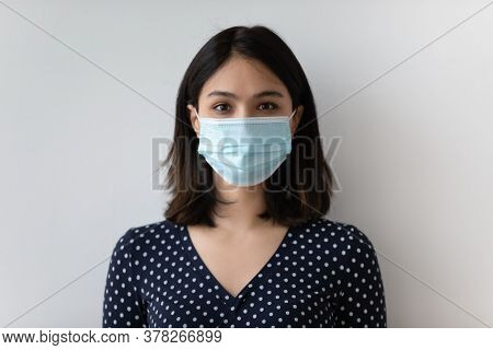 Headshot Portrait Of Asian Woman In Medical Facemask