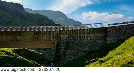 Mountain Road In Fagaras Ridge. Popular Travel Destination. Wide Serpentine. Summer Morning Scenery