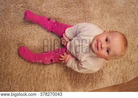 Baby Sitting On The Carpet, Baby In The Room Sitting On The Carpet And Looking Up, Shooting Baby Vie